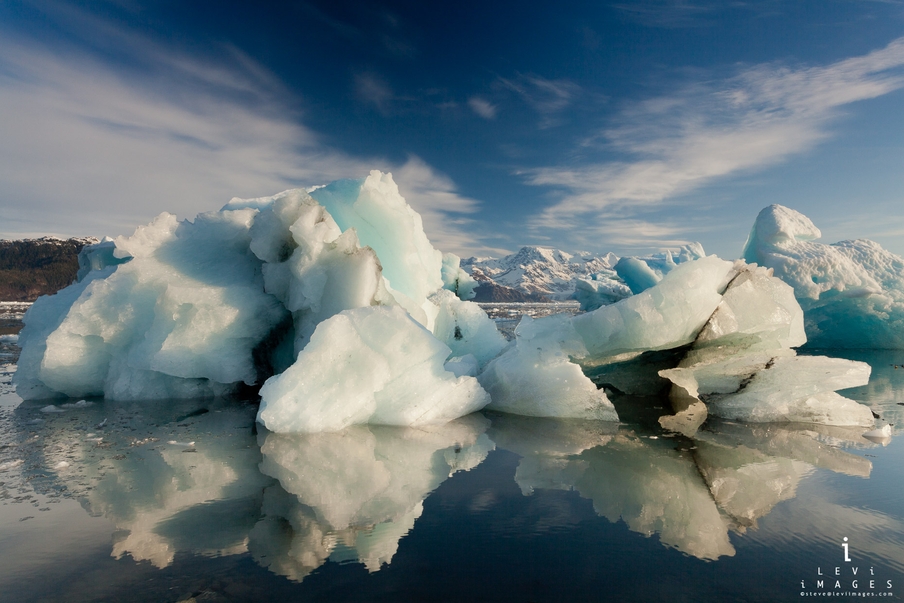 Icebergs reflected in melt water from Columbia Glacier. Prince William Sound, Alaska