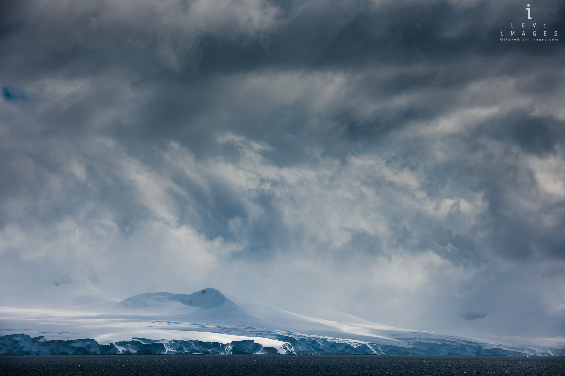 Frozen antarctic landscape with dramatic clouds. Antarctica