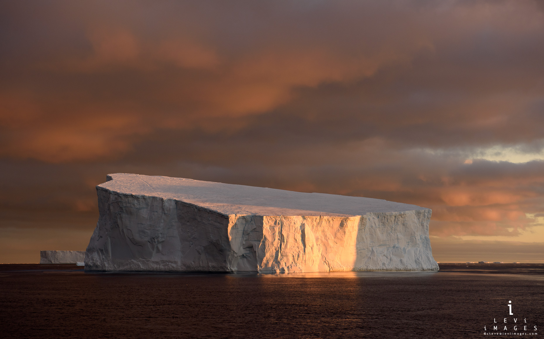 Iceberg in sunrise light. Antarctic Sound, Antarctica