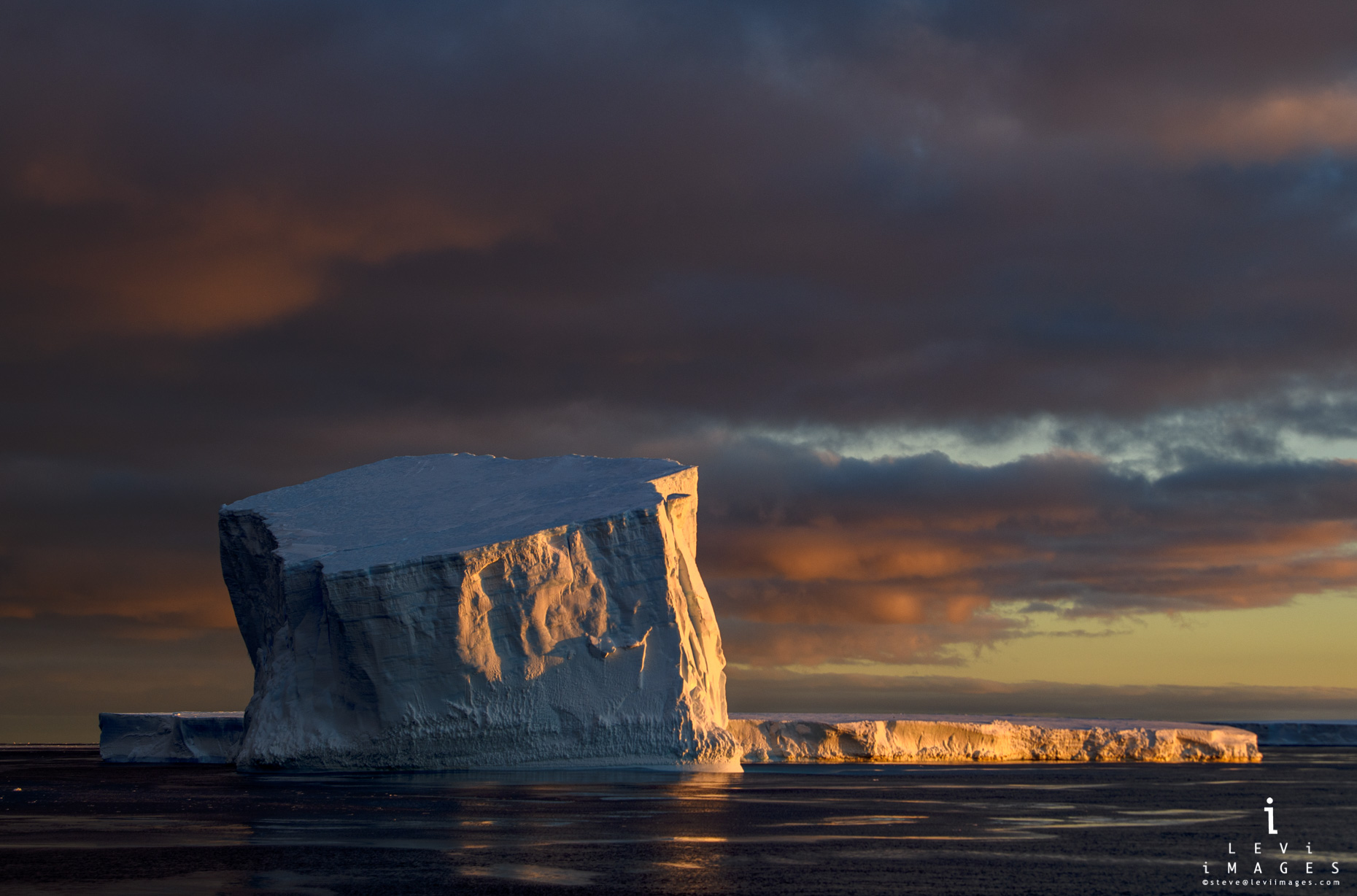 Iceberg in dramatic sunrise light. Antarctic Sound, Antarctica