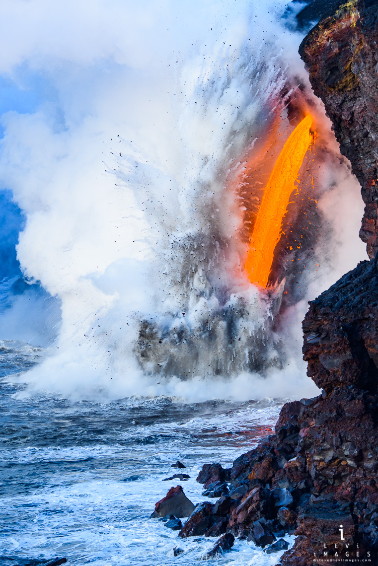 Rare lava fire hose explosively flows into the ocean, Hawaii Volcanoes National Park, Big Island, Hawaii