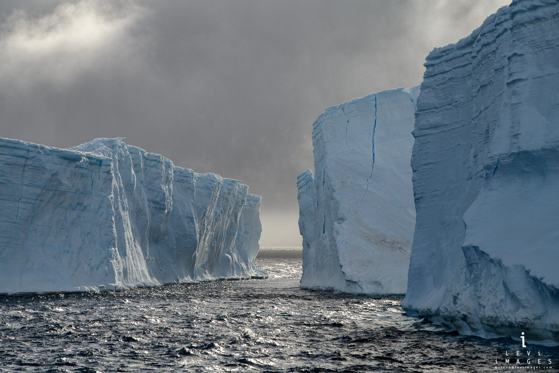 A channel opens between towering icebergs near Brown Bluff, Antarctica