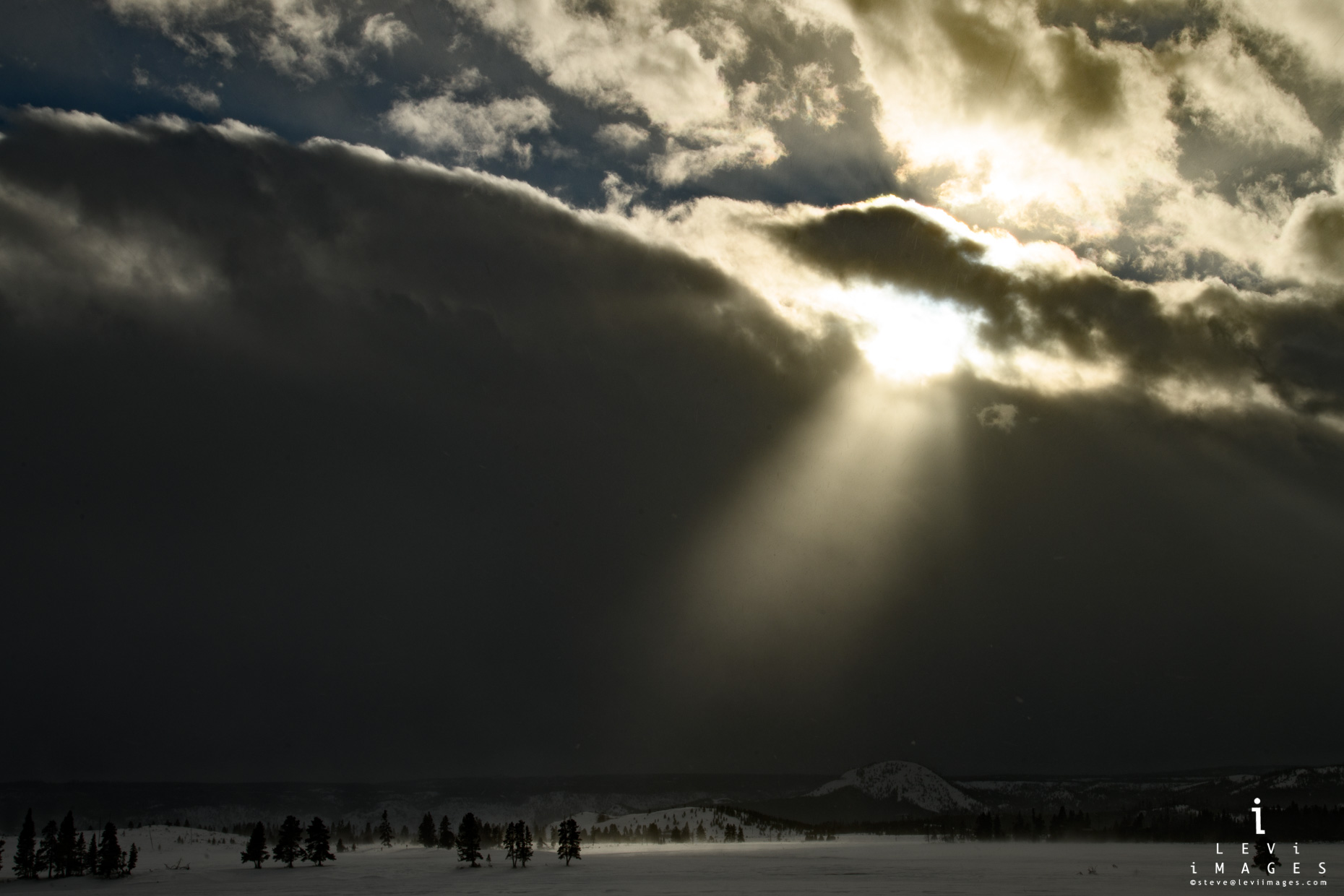 Dramatic god-beam landscape. Yellowstone National Park, Wyoming